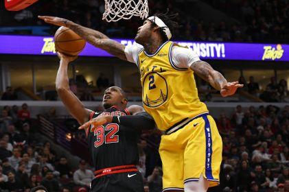 Robinson III anota 20 puntos y Warriors ganan 100-98 a Bulls