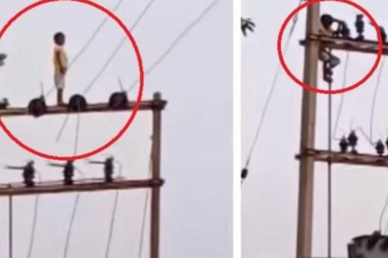 ¡Increíble! Captan a niño jugando en lo alto de un poste de 16 metros de altura