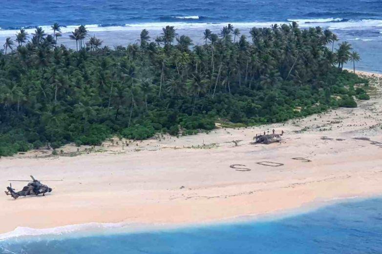 Los rescatan de isla desierta por una señal SOS en la arena